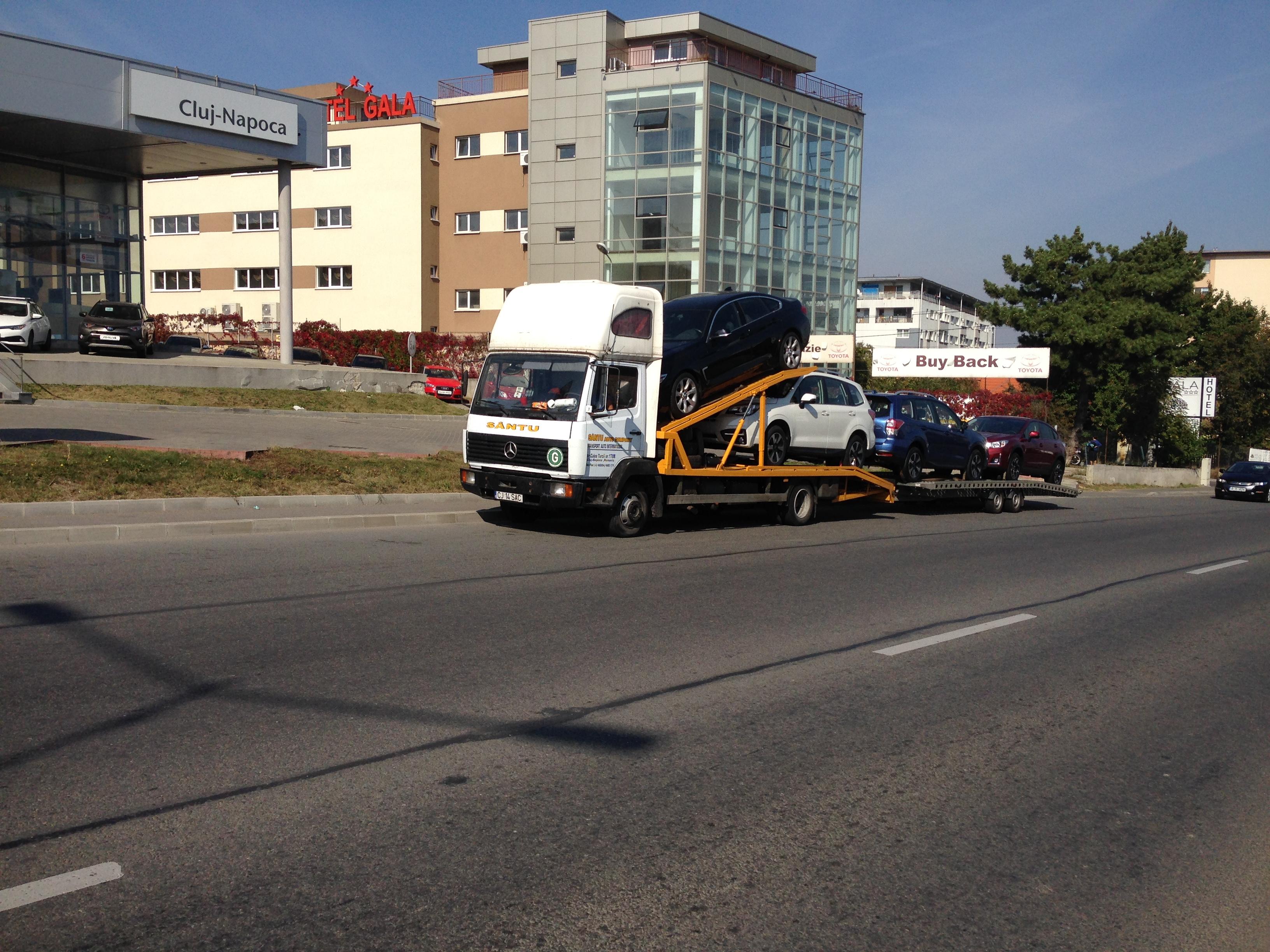 Transport mașini noi